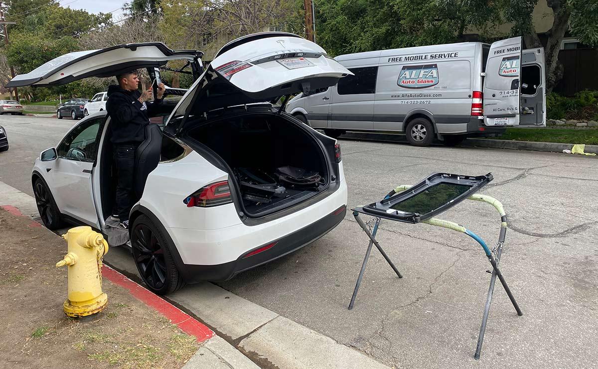Tesla Model X falcon door window replacement