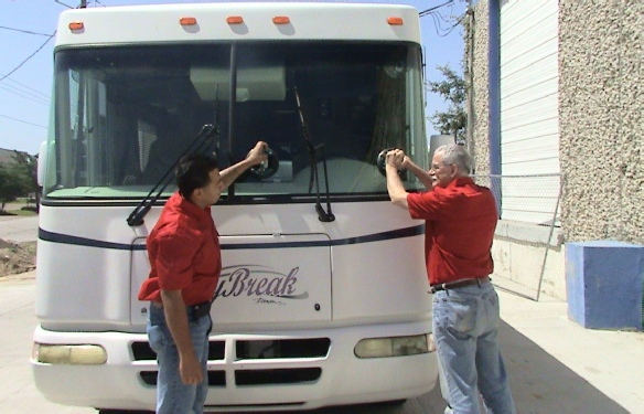 technicians installing RV windshield