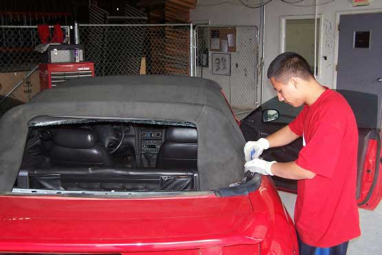technician fixing convertible top